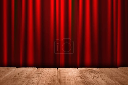 Wooden table with empty space and shiny red silk curtain background