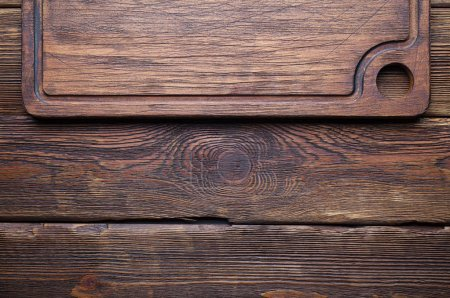 Photo for Old cutting board on wooden planks background - Royalty Free Image