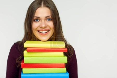Close up portrait of student girl with books pile. White back isolated.