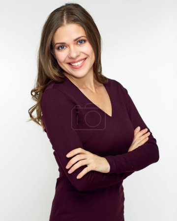 Photo for Smiling woman wearing brown dress with crossed arms posing isolated on white background - Royalty Free Image