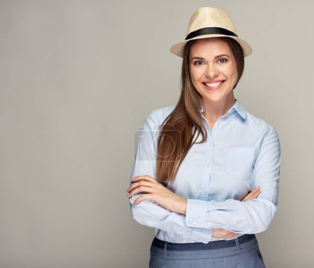 Photo for Happy smiling woman wearing hat standing with crossed arms - Royalty Free Image