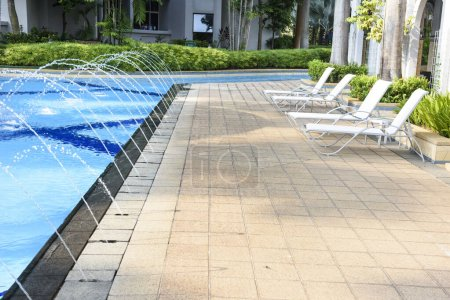 Photo for Resort area with swimming pool and chaise lounges - Royalty Free Image