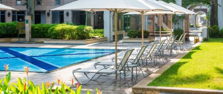 Photo for View on resort area with swimming pool and chaise lounges with umbrellas - Royalty Free Image