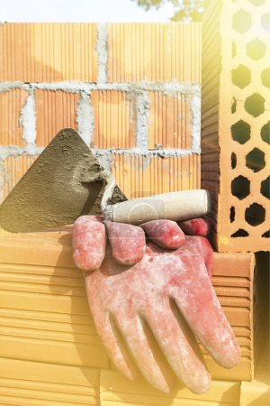 Mason bricklaying background with trowel and clay ...