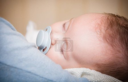 picture of a newborn baby curled up sleeping