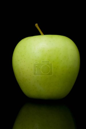 Photo for Ripe green apple on black background - Royalty Free Image
