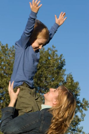 Photo for Happy mother and son having fun in park - Royalty Free Image