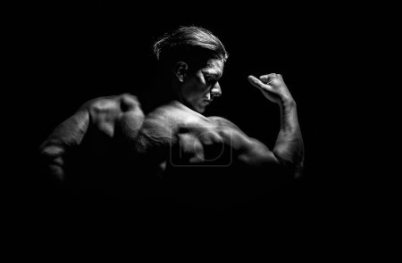 Photo for Very muscular handsome athletic man on black background - Royalty Free Image