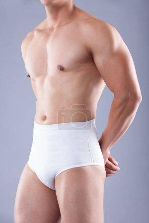 Male torso  in elastic medical shorts (anatomical ...
