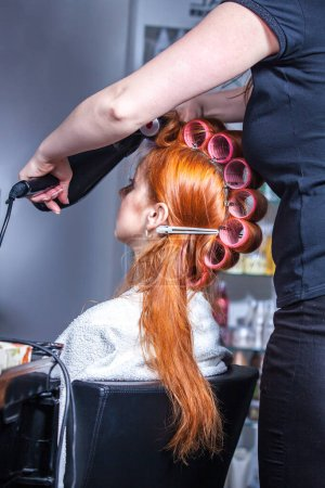 Photo for Hair styling for a woman in a female hairdresser - Royalty Free Image