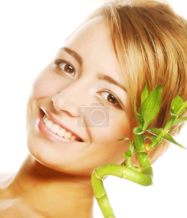 Photo for Young beautiful woman with bamboo - Royalty Free Image