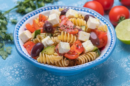 Photo for Bowl of cheese salad with fusili pasta and fresh vegetables - Royalty Free Image