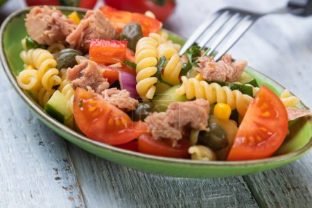Photo for Tuna salad with fusili pasta and vegetables - Royalty Free Image
