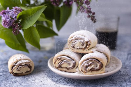 Photo for Nutella rolls with sugar and coffee - Royalty Free Image