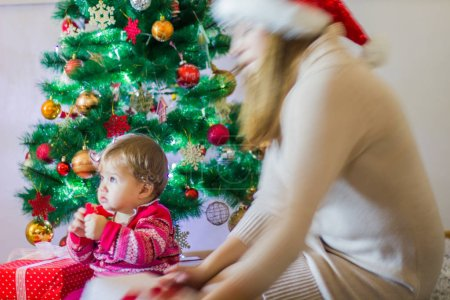 Photo for Happy Family Christmas At Home. Mother with children celebrating holidays. - Royalty Free Image