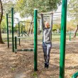 Fit Senior Woman Stretching At Outdoor Gym, Health...
