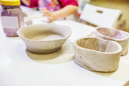Children Arts from clay on the table at workshop.