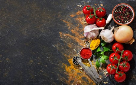 Photo for Various vegetables and spices for cooking on dark background, top view - Royalty Free Image