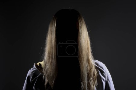 Photo for Faceless young blonde woman represent all kinds of women problems with abusing, mobing, violence or trafficking - Royalty Free Image