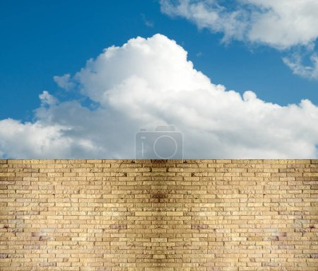 Sky clouds over stone fence...