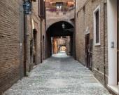 Ferrara, Italy - June 10, 2017: Via delle Volte of Ferrara in the medieval quarter. Emilia-Romagna. Italy.