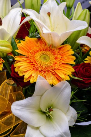 Photo for A beautiful bouquet of white lilies and orange gerberas - Royalty Free Image