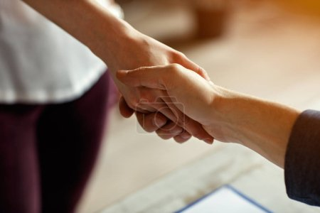 Photo for Female and male shake hands on meeting indoor - Royalty Free Image