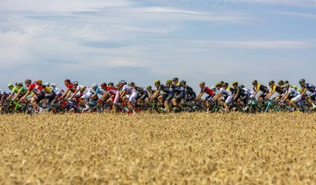 France, Vendeuvre-sur-Barse - July 6, 2017: peloton passing through region of wheat fields during stage 6 of Tour de France 2017