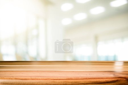 Photo for Empty table for present product with office background. - Royalty Free Image