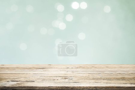 Photo for Wood table top on mint  bokeh abstract background and used for montage or display products. - Royalty Free Image