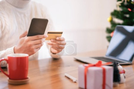 Photo for Man holding credit card and doing shopping online. New year, Christmas gift shopping - Royalty Free Image