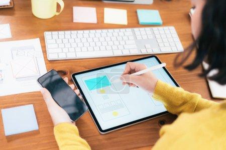 Photo for Web designer, UX UI designer designing mobile application user interface. Creative planning application development sketch layout wireframe design. - Royalty Free Image