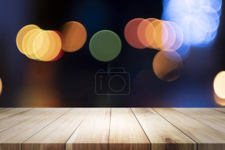 Photo for Empty wooden table for present product on coffee shop or soft drink bar blur background with bokeh image - Royalty Free Image