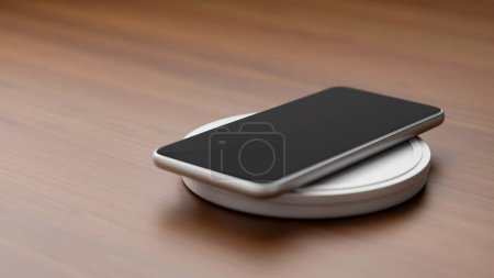 Photo for Copyspace of mobile phone charging battery with wireless charger on working table. - Royalty Free Image