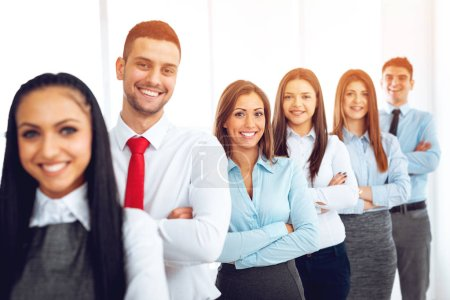 Photo for Smiling group of young business people standing with arms crossed and posing at camera - Royalty Free Image
