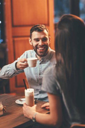 Photo for Romantic loving couple drinking coffee having date in cafe - Royalty Free Image