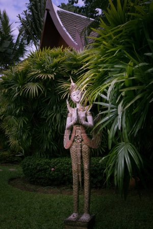 view of wooden antique  thai style statue on green back