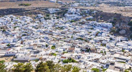 Cityscape of Lindos ancient city with whitewashed little houses densely located each other and narrow streets on Rhodes island