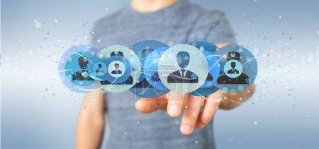 Photo pour Vue d'un homme tenant un concept de réseau de contact professionnel rendu 3D - image libre de droit