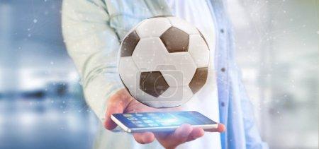 Photo pour Vue d'un homme tenant un Football ball et connexion isolé rendu 3d - image libre de droit