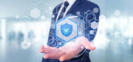 Photo pour Vue d'un homme tenant un concept de sécurité web Shield rendu 3d - image libre de droit