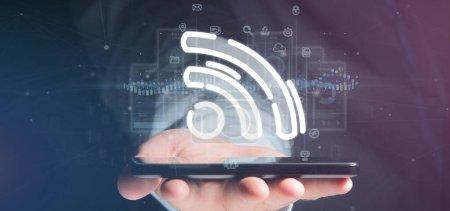 Photo pour Vue d'un homme d'affaires tenant une icône wifi avec des données tout autour - image libre de droit