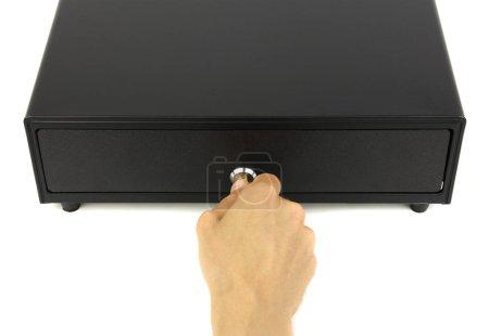 Photo pour Tiroir-caisse noir fermé ou caisse et main avec clé dans serrure, fond blanc vue du dessus, concept d'audit financier ou inspection du commerce - image libre de droit