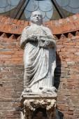 Saint Eufemia statue on the portal of Saint Eufemia Gothic-style, Roman Catholic church in Verona, Italy