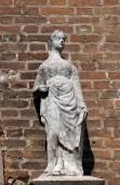 Female statue on the portal of Saint Eufemia Gothic-style, Roman Catholic church in Verona, Italy