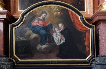 Saint Stanislaus Kostka reciving the infant Jesus, Adoration of the Magi altar in Jesuit church of St. Francis Xavier in Lucerne, Switzerland