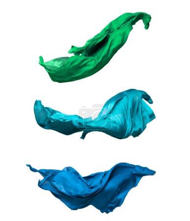 Photo pour Abstrait morceau de tissu de teal battant, coup de studio à grande vitesse - image libre de droit