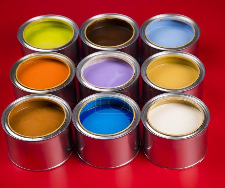 Photo for Paint cans color palette, red background - Royalty Free Image