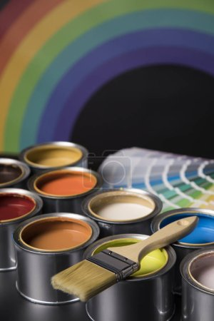Photo for Tin cans with paint, brushes and bright palette of colors - Royalty Free Image