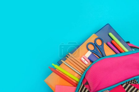 Photo for Back to school concept. Backpack with school supplies on colored background - Royalty Free Image